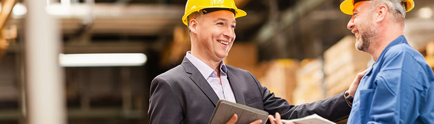 Businessman in hard hat on job site