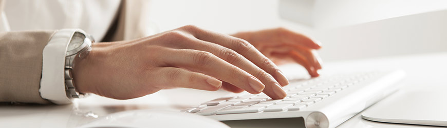 Female hands working at computer
