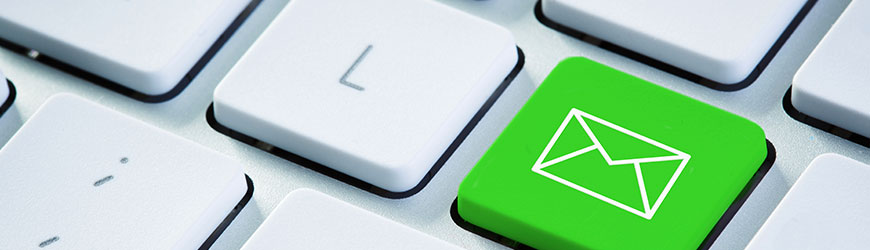Keyboard with green email icon